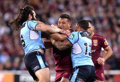 Canberra Raiders rep Josh Papalii of the Maroons takes on the defence during game one of the State Of Origin series between the Queensland Maroons and the New South Wales Blues at Suncorp Stadium on May 31, 2017 in Brisbane, Australia. - State Of Origin I - QLD v NSW