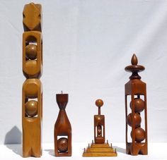 A set of four elegantly carved whimsies by the same anonymous maker. #FolkArt