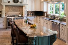 Ibere Crema Bordeaux is the granite used on both the island and main counters of this beautiful kitchen. The intricate edging and corner details on the island really add character to the overall design.
