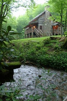 Log Home with a stream