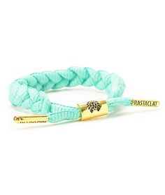 Accessorize your looks with a bright turquoise braided shoelace with a gold metal adjustable cylinder sizing piece and gold metal aglets with Rastaclat logos.
