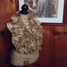 Metallic Gold and Cream Fine Knit Scarf Metallic Gold and Cream Fine Knit Scarf Great skill and detail went into creating this beauty! Very long, shown tripled on the dress form. There is snagging in spots.  Pictures don't show the scarf's true sparkle! Accessories Scarves & Wraps