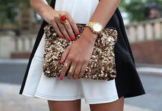 Sparkly gold clutch + coral ring