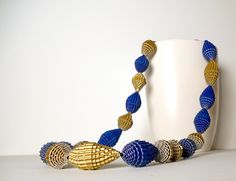 Blue and Gold: Statement Necklace FILA with Beads of Corrugated Cardboard. €25.00, via Etsy.