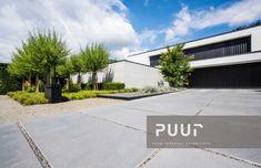 Moderne woning met strakke voortuin PUUR groenprojecten tuinarchitectuur - tuinaanleg Alken