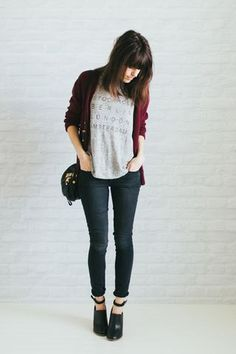 Gray graphic tee, red cardigan, black jeans, black ankle boots