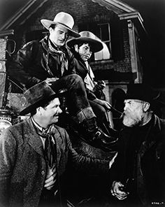 John Wayne, George Bancroft, Andy Devine, and Francis Ford in Stagecoach (1939)