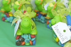 1st birthday party favors for pool theme. Turtle water toys from Oriental Trading and little man's face on custom chocolate candy. This is still one of my favorite ideas ever!