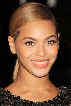 beyonce metball side part ponytail