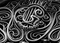 Gaudi – Palau Guell. Art Nouveau (Modernist) wrought iron grill above the main entrance to the residence in central Barcelona.