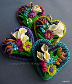 polymer clay art by RMK designs. Lovely little spring brooches or pendants. #polymer #clay #jewelry
