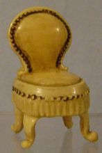 What a great chair! I've seen a lot of figural tape measures but I never seen this one before. It can be found in Paulann Turner's shop on Ruby Lane.