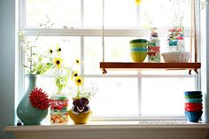 """The point of this pin is the fabric covered jars! But I like the """"swing"""" shelf! It would solve a problem window in the kitchen... on those rare days when I want to pull down the blinds I can swing the shelf out of the way!"""