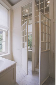 :: Havens South Designs :: loves french doors and windows. These doors are metal. The windows and transom are wonderful.