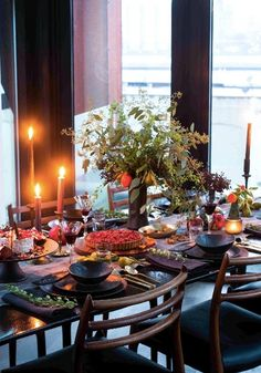 Your love of seasonal entertaining is sure to be showcased this holiday season with this gorgeous dinner party table setting inspiration. An autumn color palette with expressive jewel tones matches perfectly with the rustic details of this tablescape idea!