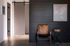black painted horizontal boards with a deep groove. I like the contrast with the white on the wall/door in the background. It gives more depth to the room. Midcentury by Brown Design Group