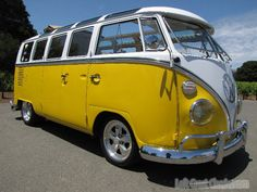 My dad used to have a VW van but it wasn't nearly this nice. Love this yellow and white paint job and all the shiny chrome!