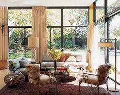 Love big windows, it looks like the living room is in the garden. Great layout, beautiful furniture.