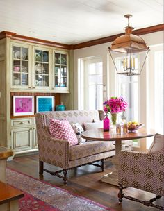 Eat-in kitchens are another trend, with more homes including generously sized casual dining areas within or near kitchen space.  Upholstered settees face an oval pedestal table in this Boston area kitchen designed by Liz Caan.