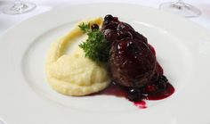 Venison fillet with blueberries served alongside a silky potato pure Venison, Beef, Blueberries, Potato, Steak, Restaurant, Pure Products, Drink, Food