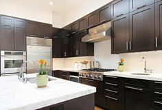 Shaker-style cabinetry with modern pulls and a marble top. Clean, contemporary.