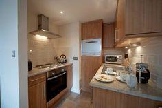 Studio apartment kitchen  I like the subway tile in white....