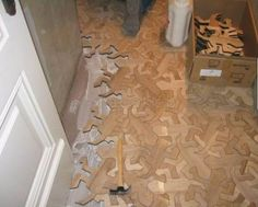 Wooden Floor inspired by M.C. Escher's art work. Must have! Or at least must have a CNC lathe to cut my own pieces...