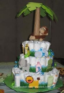 Diaper cake... like the whimsy of the monkey climbing the tree.