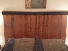 DIY headboard: laminate flooring and left over base trim painted brown