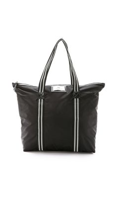 Day Gweneth Ribbon #Tote  A substantial DAY BIRGER ET MIKKELSEN tote rendered in resilient nylon. A logo patch trims the front, and faux #leather trims the zip top. Lined, single-pocket interior. Striped top handles.