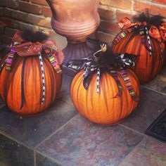 Pumpkins wrapped in black tulle and Halloween ribbon from the Dollar Tree-cute, easy and inexpensive.