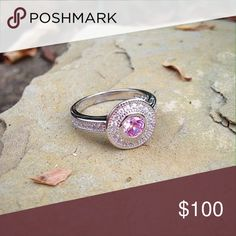 Solid sterling silver pink sapphire and topaz ring Sparkling pink sapphire and white topaz in a solid sterling silver setting. Makes a great alternative engagement ring ! Jewelry Rings