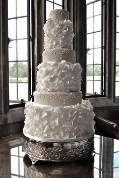 The ruffle tiers are really cool! I would make the cake less formal for mine though
