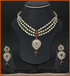 $183 JWR6611 : Maroon, Green and Off White Polki Studded Necklace Set