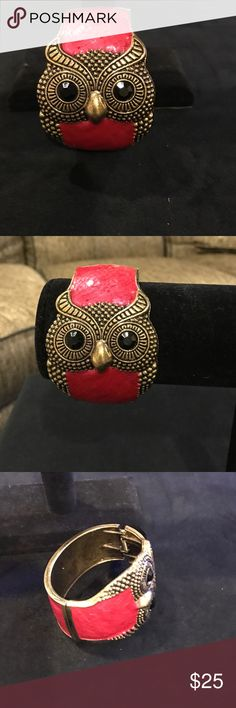 NWT Owl Bracelet in Red Enamel with Gold tone NWT Owl Bracelet in Red Enamel with Gold tone. Black onyx like stones for eyes. Hinged. Great statement piece. Beautiful shade of red. Smoke free home Jewelry Bracelets