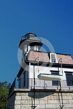 Photo about This is an old historic light house with a life boat hanging off the side. This building is on display at Shelburne Museum in Vermont. Image of museum, hoist, display - 74212137 Shelburne Museum, Photo Lighting, Light House, Vermont, Boats, Ships, Stock Photos, Display, Mansions