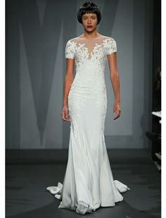 I saw this Mark Zunino dress on Say Yes to the Dress. Doesn't look the best on the model but it was beautiful on the show.