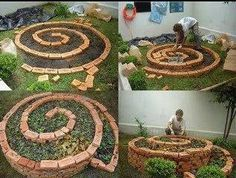 circle raised planter ... fill with TONS of mixed color flowers and plants for a rainbow