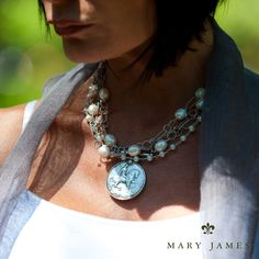 Mary James Jewelry. A typical Mary James piece will contain precious and semi-precious stones embellished with historic artifacts, medals, fobs and coins from around the world. The medals dictate how the piece will be finished. Each unique piece is accompanied by a personal story, ensuring that it is a heirloom to be passed down generations to come.