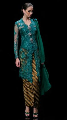 A traditional blouse-dress combination that originates from Indonesia. Kebaya Lace, Kebaya Hijab, Kebaya Brokat, Batik Kebaya, Kebaya Dress, Kebaya Muslim, Batik Dress, Blouse Dress, Kimono