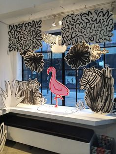 Alice Bowsher recently created this cardboard jungle bonanza window display for…