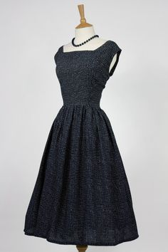 1950s retro tea dress - I think I could really enjoy some clothes from this time period. Future sewing project perhaps?