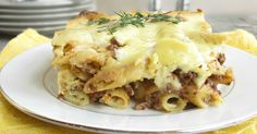 Recipe for a Greek style casserole with spiced beef, pasta and yogurt bechamel sauce.