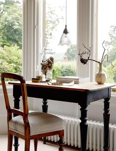 Jennifer Bristow-Smithpositioned her desk in front of a very appealing window in her recently renovated Victorian home in south-west Scotland.  The lighting is a dominant feature in the house, and it has been used to create interest and intimacy in equal measure. Desks or tables in bay windows are illuminated by low hanging pendants, as is the sitting room coffee table, which is served by a pair.