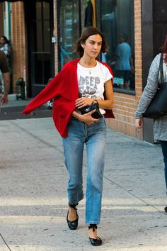 Alexa Chung Photos Photos - Alexa Chung is seen out and about in NYC on September 13, 2016. - Alexa Chung Sports a Bright Red Sweater