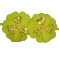 Sequin Felt Flowers on elastic skinny band. These bands add just the right amount of sparkle and dress up any outfit perfectly.  While these are perfect for newborn, babies, and all age girls, these are very popular for adults. Moo G Clips has a lot of loyal adult customers wearing the Sequin Felt Flowers Skinny Band. Yellow