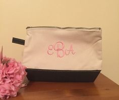 Various trim colors for this canvas makeup bag that is a cute monogram makeup bag that makes a perfect travel accessory making this an ideal cosmetic case. This monogrammed cosmetic zippered canvas bag is a perfect companion to our larger canvas bags!  This listing is for 1 cosmetic/makeup bag with a monogram.  Details: Dimensions 7x11x3 Zippered closure  At checkout in notes to seller add thread color and F--L--M monogram information or name for the bag  example: Brooklyn Marie Stuart ...