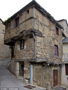 This ancient house in Aveyron, France, dates back to the 13th Century and was built top-heavy as a cost-saver, because at the time, homes were taxed on ground-floor square footage