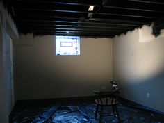 painting an industrial ceiling black | open basement, basements
