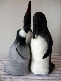 Wet felted Penguin Family. Moma & Papa are doorstoppers, baby is a cuddly toy with a beanie bottom so he stands up. Felters Journey
